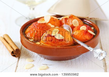Summer dessert: Apricot tagine with cinnamon and almond petals