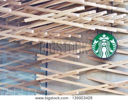 FUKUOKA, JAPAN - JULY 16, 2016: Starbucks coffee shop beside road to Dazaifu Tenmangu, a popular Shinto shrine in Fukuoka, Japan. Designed by Kengo Kuma. Starbucks is the world's largest coffee house chain.