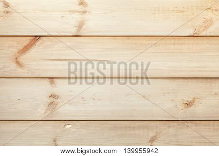 The texture of the old rustic gnarled planks. Wooden light vintage background.