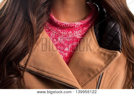 Beige collar with black insert. Pink piece of clothing. Warm spring apparel. Woolen sweater and fleece coat.