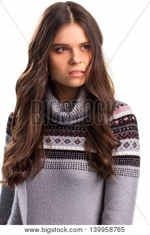 Woman with suspicious face. Printed sweater on white background. Haven't I seen him before. Need some time to think.