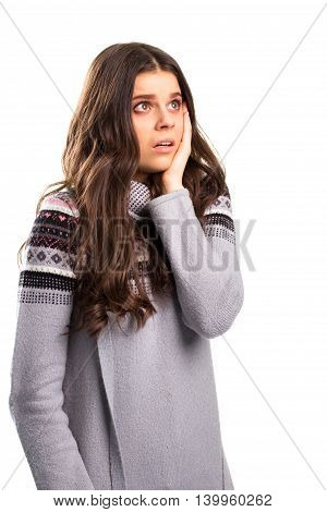 Young lady with horrified face. Woman in patterned sweatshirt. Stress and shock. What could have gone wrong.