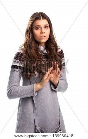 Terrified girl on white background. Patterned long sleeve top. Forget what you saw. Scary truth is uncovered.