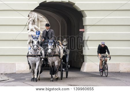 VIENNA, AUSTRIA, JULY 3,2016: Vienna is famous for Fiacres (Fiaker),hackney coach, a horse-drawn four-wheeled carriage for hire. One of the most attractive tourist attraction in Vienna.