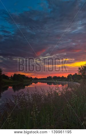 Sunset Clouds Over The River Bend