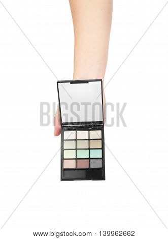Professionnal make-up brush cosmetic in female hand beautician isolated on white background