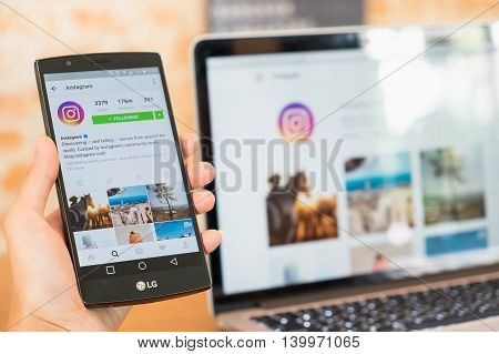 CHIANG MAI THAILAND - JUL 18 2016: A man hand holding lg g4 with instagram application. Instagram is largest and most popular photograph social networking.