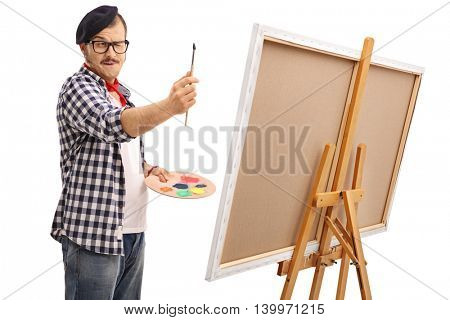 Young artist measuring proportions with a paintbrush isolated on white background