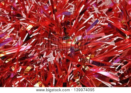 A full frame of red Christmas tree tinsel