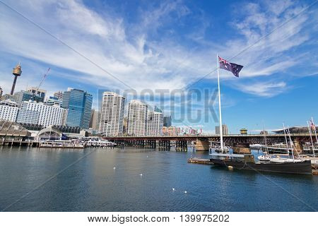 SYDNEY, AUSTRALIA - APRIL, 2016 : Pyrmont Bridge and Cockle Bay in Darling Harbour, Port Jackson in Sydney, Australia on April21, 2016. The bridge only carried pedestrian and bicycle traffic.
