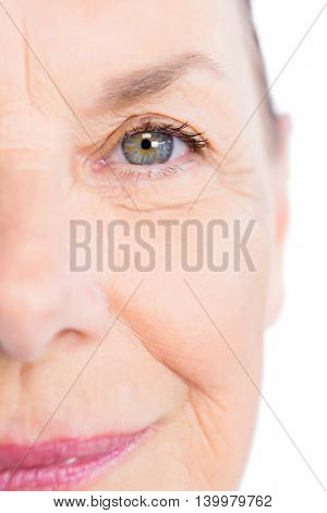 Cropped mage of mature woman against white background