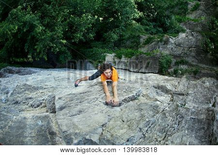 male rock climber. rock climber climbs on a rocky wall.