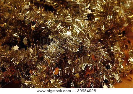 A full frame of gold Christmas tree tinsel