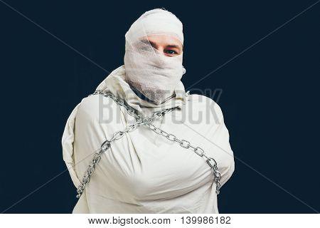 Mentally unstable patient in chains and straitjacket