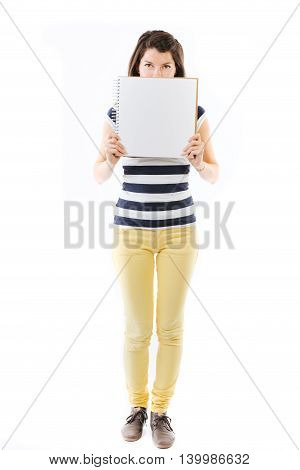 Standing young woman with writable white page - isolated on white
