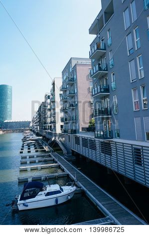 View of a yacht anchored at Main's shore near private homes in Frankfurt Germany