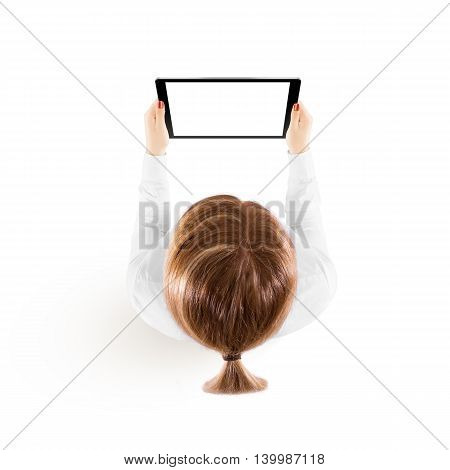 Woman hold tablet pc mockup in hand top view isolated on white. Black mobile ebook mock up holding in female hands from above. Blank tablet screen monitor. Clear horizontal ipad display booklet person