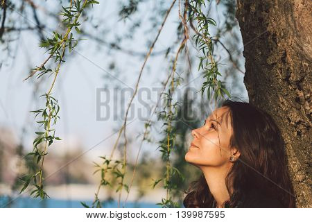 Closeup of a beautiful young woman relaxing outdoor sand enjoying nature