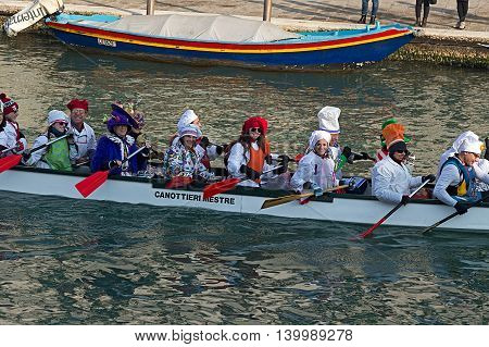VENICE ITALY - JANUARY 24 2016: Carnival procession on the Cannaregio Canal on January 24 2016 in Venice Italy.
