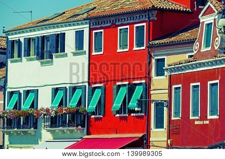 Colorful apartment building in Burano Italy an island with colorful architecture in the Venetian Lagoon. Vintage processing.