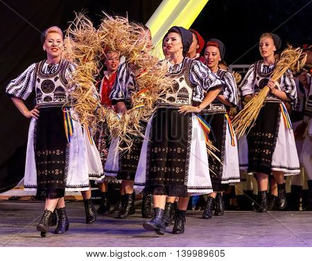 """ROMANIA TIMISOARA - JULY 7 2016: Young dancers from Romania in traditional costume present at the international folk festival """"International Festival of hearts"""" organized by the City Hall Timisoara."""