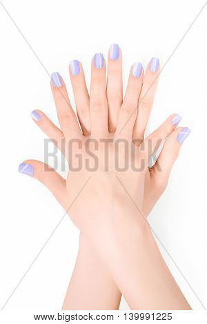 Hands with violet shellac art manicure isolated on white with clipping path
