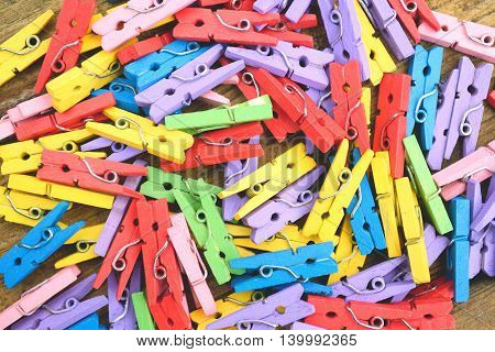 Large group of very colorful pegs as abstract background