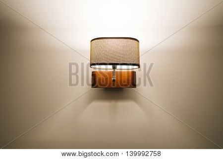 Modern lamp hanging on a white wall