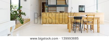 Classical Wooden Table In Dining Room Interior