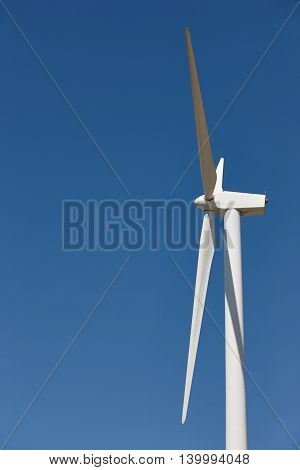 Wind turbines in a forest. Clean alternative renewable energy. Horizontal