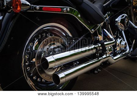Black Motorcycle Dual Chrome Exhaust Pipes Side View