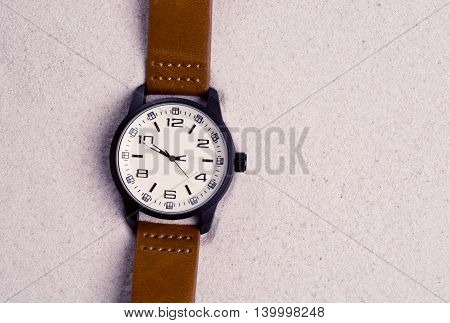 vintage Watch on the Sand Beach selective focus.