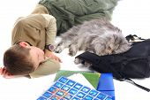 Young boy fell asleep with big silver cat poster