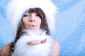 Winter Girl with beautiful make up, silver gloves  and snow flake, blue background poster
