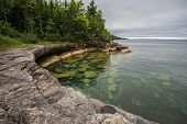 Cove On The Coast Of Lake Superior  In Michigan. Cliff on the shores of Lake Superior in Michigan's Upper Peninsula. poster