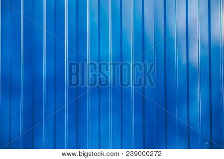 Background And Texture Of Blue Color Corrugated Metal Sheet With Shadow And Hilight Effect.