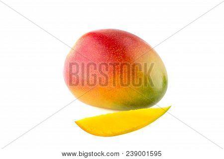 Fresh Mango On White Background. A Mango Fruit And A Lobule Isolated On White Background.
