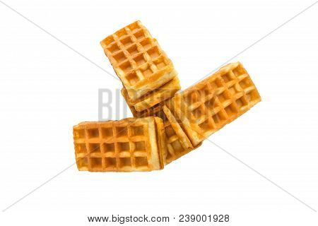Soft Waffles With A Filling. Several Waffles With A Cream Filling On A White Background. Top View.