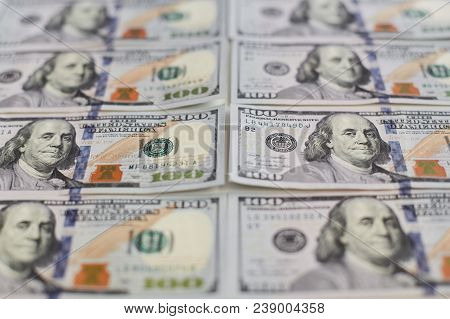 Background From The Close Up View Of Hundreds Dollars Banknotes, Rows Of Stacks Of Dollars In Hundre