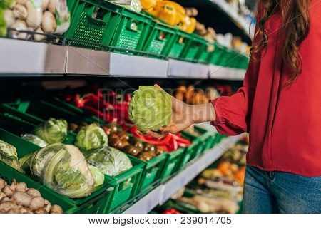 Partial View Of Shopper Choosing Fresh Raw Cabbage In Hypermarket