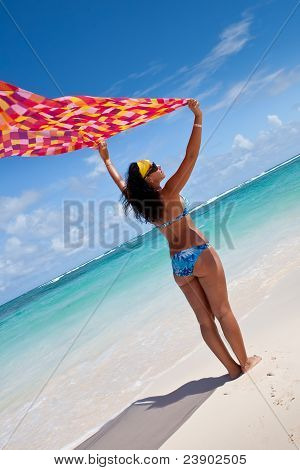 Tanned Young Europen Women With Red And Orange Pareo On White Sand Beach