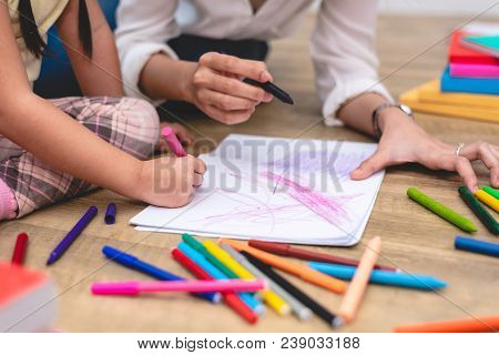 Closed Up Hands Of Mom Teaching Little Children To Drawing Cartoon In Art Class With Color Pen. Back