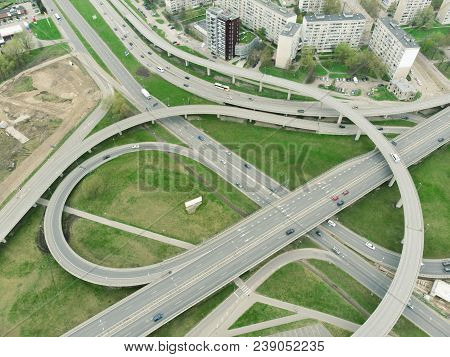 Aerial highway junction. Highway from aerial view. Urban highway and lifestyle concept. Construction of additional concrete road curve of viaduct in Riga, Latvia poster