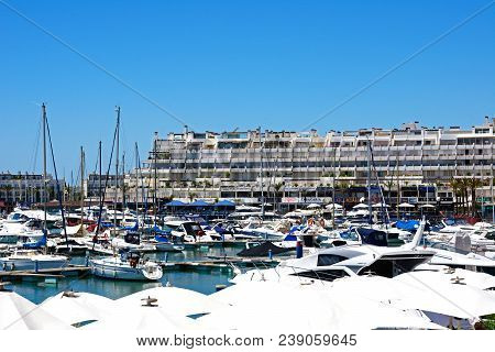 Vilamoura, Portugal - June 6, 2017 - View Of Yachts In The Marina With Waterfront Shops And Restaura
