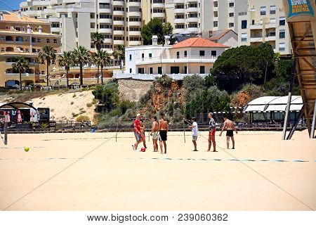 Portimao, Portugal - June 7, 2017 - Group Of Teenage Boys Playing Football On The Beach, Portimao, A