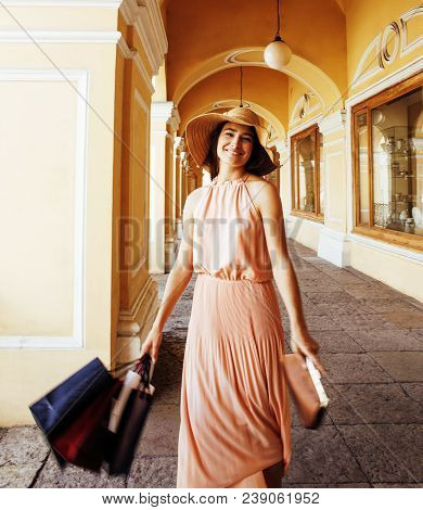 Young Pretty Smiling Woman In Hat With Bags On Shopping At Storefront, Lifestyle Real People Concept