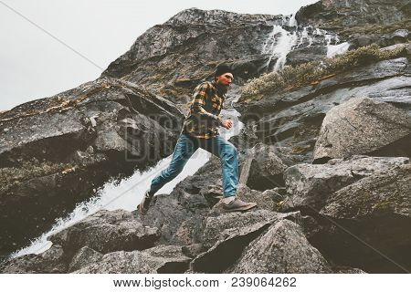Running Man in waterfall rocky mountains travel adventure healthy lifestyle endurance concept skyrunning sport poster