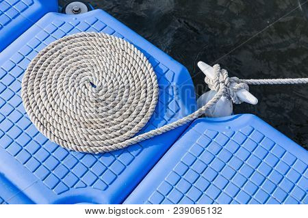 Rope On Plastic Pontoon Floating In The Sea, Plastic Floating Dock, Rope Tied Into A Circle