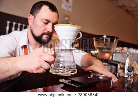A Professional Barista Prepares Coffee Using An Alternative Method Of Brewing.drip Coffee Or Pour-ov