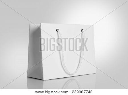 White Paper Shopping Bag On Gray Background For Mockups